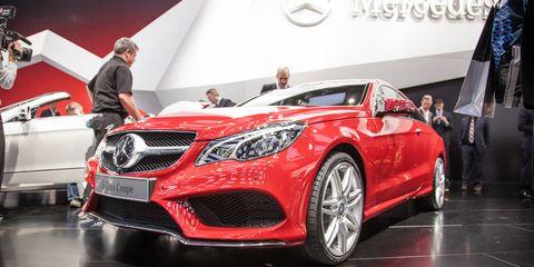 Wheel, Automotive design, Vehicle, Land vehicle, Event, Car, Automotive lighting, Grille, Personal luxury car, Flag,
