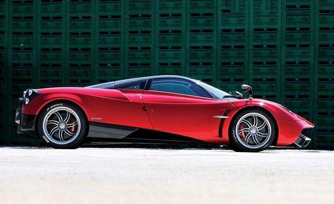 Tire, Wheel, Mode of transport, Automotive design, Vehicle, Land vehicle, Car, Automotive lighting, Red, Rim,