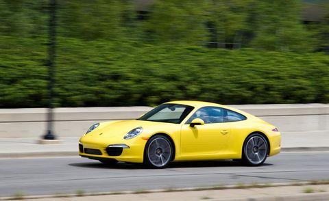Tire, Wheel, Automotive design, Vehicle, Yellow, Land vehicle, Performance car, Car, Rim, Supercar,