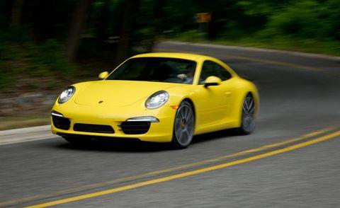 Wheel, Automotive design, Yellow, Road, Vehicle, Car, Performance car, Road surface, Asphalt, Rim,