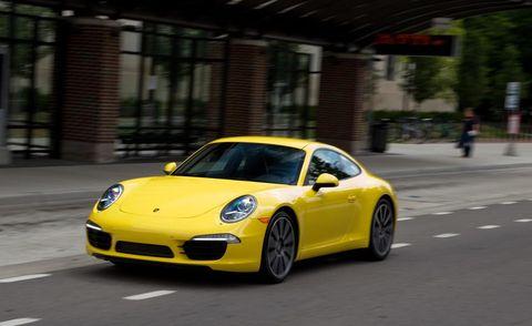 Automotive design, Yellow, Vehicle, Car, Rim, Performance car, Fender, Sports car, Alloy wheel, Asphalt,