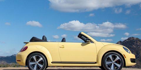Wheel, Tire, Automotive design, Vehicle, Yellow, Automotive exterior, Rim, Landscape, Alloy wheel, Vehicle door,