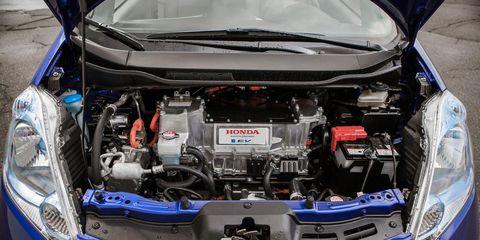 Car, Engine, Automotive exterior, Automotive engine part, Electric blue, Hood, Bumper, Trunk, Personal luxury car, Luxury vehicle,