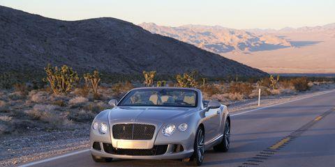 Road, Vehicle, Automotive design, Infrastructure, Mountainous landforms, Car, Mountain range, Grille, Highland, Road surface,