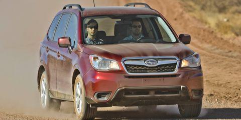 Tire, Wheel, Motor vehicle, Daytime, Vehicle, Automotive design, Natural environment, Transport, Land vehicle, Automotive mirror,