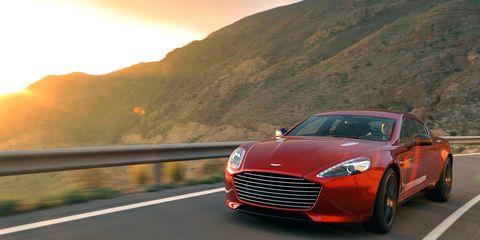 Tire, Automotive design, Sun, Vehicle, Car, Rim, Grille, Logo, Performance car, Alloy wheel,