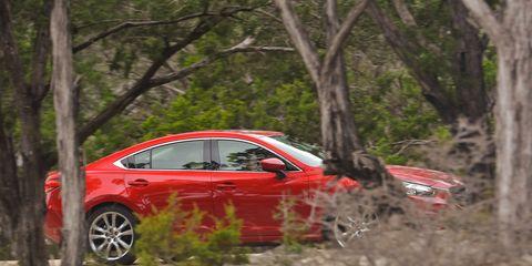Vehicle, Land vehicle, Car, Alloy wheel, Rim, Mid-size car, Sedan, Auto part, Luxury vehicle, Sports car,