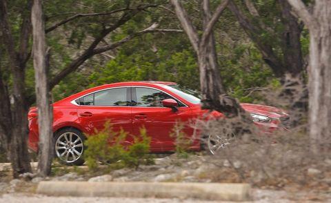 Vehicle, Land vehicle, Car, Alloy wheel, Mid-size car, Sedan, Rim, Auto part, Full-size car, Luxury vehicle,