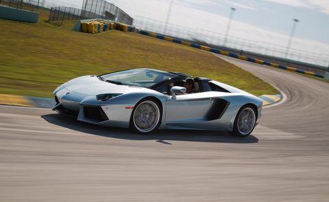 Tire, Wheel, Mode of transport, Automotive design, Vehicle, Rim, Infrastructure, Automotive lighting, Performance car, Car,