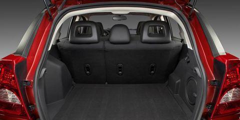 Vehicle, Trunk, Automotive design, Car, Automotive tail & brake light, Luxury vehicle, Bumper, City car, Vehicle door, Family car,