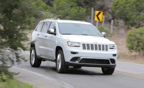 Tire, Motor vehicle, Wheel, Automotive tire, Road, Daytime, Vehicle, Automotive mirror, Automotive design, Infrastructure,