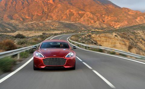 Road, Automotive design, Mode of transport, Automotive mirror, Infrastructure, Mountainous landforms, Grille, Car, Highland, Logo,