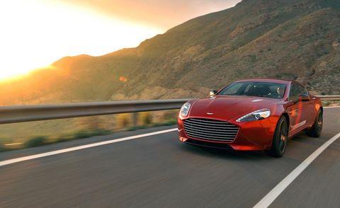 Automotive design, Road, Mountainous landforms, Car, Rim, Highland, Grille, Automotive lighting, Logo, Personal luxury car,