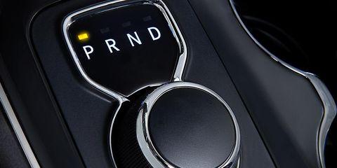Automotive design, Logo, Luxury vehicle, Symbol, Carbon, Gear shift, Silver, Personal luxury car,