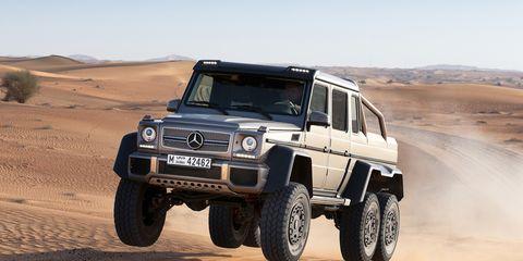 Tire, Wheel, Automotive tire, Automotive design, Sand, Automotive exterior, Natural environment, Vehicle, Land vehicle, Aeolian landform,