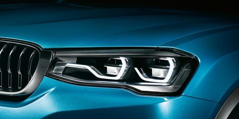 Motor vehicle, Automotive design, Blue, Automotive exterior, Grille, Car, Electric blue, Teal, Light, Logo,