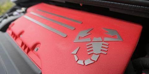 Motor vehicle, Red, Carmine, Logo, Symbol, Motorcycle accessories, Emblem, Hood, Kit car,