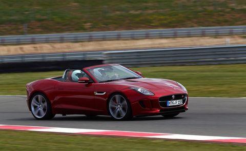Tire, Wheel, Automotive design, Vehicle, Road, Performance car, Car, Red, Fender, Automotive mirror,
