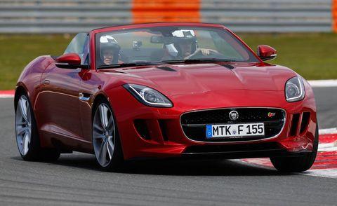 Tire, Automotive design, Vehicle, Land vehicle, Car, Red, Performance car, Hood, Fender, Automotive mirror,