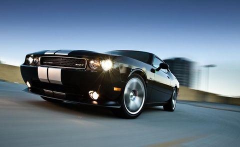Tire, Motor vehicle, Wheel, Mode of transport, Automotive design, Automotive mirror, Automotive tire, Automotive exterior, Vehicle, Automotive lighting,