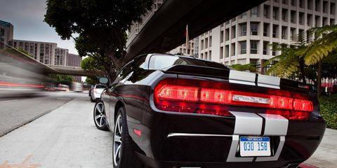 Mode of transport, Automotive tail & brake light, Automotive design, Vehicle, Road, Vehicle registration plate, Automotive lighting, Automotive exterior, Infrastructure, Performance car,