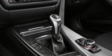 Motor vehicle, Automotive design, Personal luxury car, Luxury vehicle, Center console, Vehicle door, Gear shift, Carbon, Steering part, Steering wheel,
