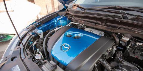 Motor vehicle, Engine, Hood, Automotive engine part, Electric blue, Personal luxury car, Automotive air manifold, Automotive super charger part, Automotive fuel system, Fuel line,