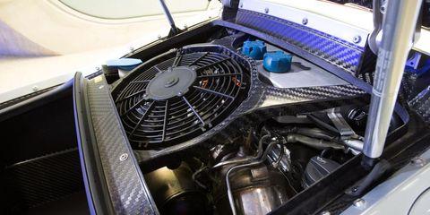 Automotive design, Carbon, Personal luxury car, Hood, Luxury vehicle, Automotive engine part, Classic, Electric fan, Engine, Machine,
