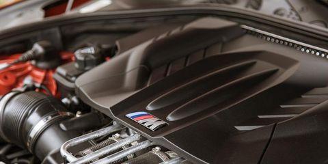 Automotive design, Metal, Engine, Carbon, Pipe, Automotive engine part, Motorcycle accessories, Steel, Automotive fuel system, Automotive air manifold,