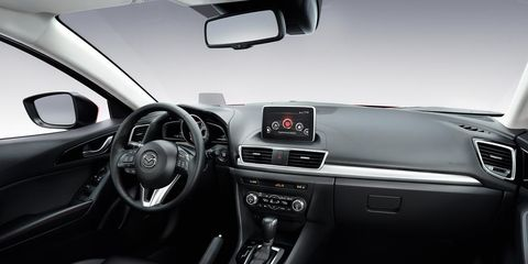 Automotive mirror, Steering part, Automotive design, Steering wheel, Vehicle, White, Car, Center console, Rear-view mirror, Personal luxury car,