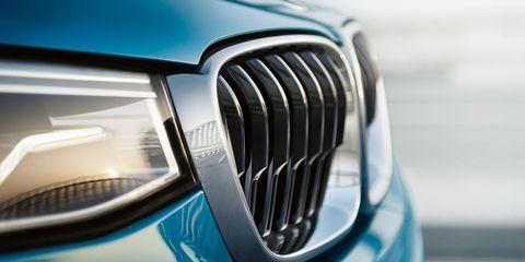 Motor vehicle, Blue, Automotive design, Automotive exterior, Grille, Car, Hood, Teal, Light, Aqua,