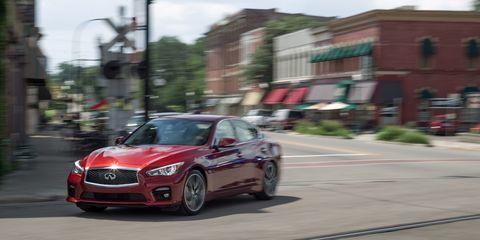 Motor vehicle, Road, Automotive design, Automotive mirror, Mode of transport, Vehicle, Infrastructure, Grille, Street, Car,