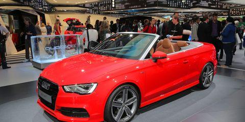 Tire, Wheel, Automotive design, Vehicle, Event, Land vehicle, Car, Auto show, Audi, Alloy wheel,