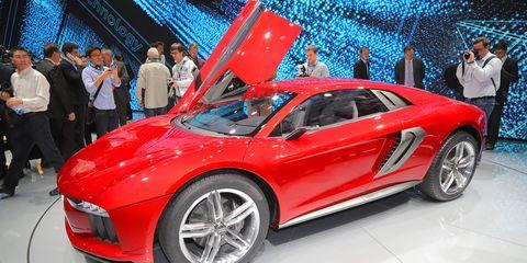 Tire, Automotive design, Vehicle, Land vehicle, Event, Car, Auto show, Exhibition, Performance car, Fender,