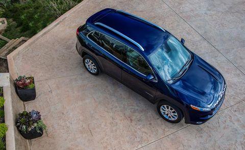 Tire, Automotive design, Flowerpot, Vehicle, Automotive mirror, Land vehicle, Automotive parking light, Automotive tire, Rim, Car,