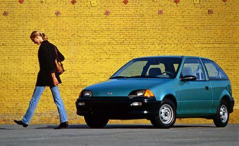 Wheel, Tire, Automotive design, Yellow, Vehicle, Land vehicle, Automotive parking light, Transport, Infrastructure, Car,