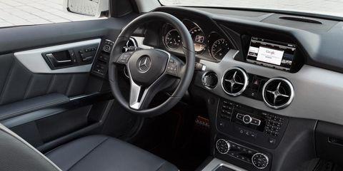 Motor vehicle, Steering part, Steering wheel, Automotive mirror, Center console, Automotive design, Vehicle audio, White, Vehicle door, Personal luxury car,