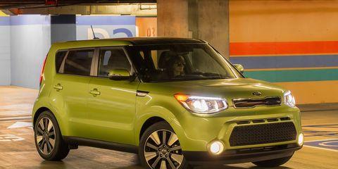 Tire, Motor vehicle, Wheel, Automotive design, Vehicle, Land vehicle, Yellow, Automotive mirror, Car, Vehicle door,
