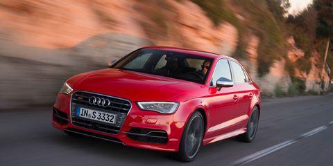 Tire, Automotive design, Automotive mirror, Road, Vehicle, Infrastructure, Automotive lighting, Car, Red, Grille,