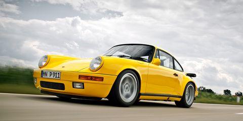 Tire, Automotive design, Yellow, Vehicle, Transport, Automotive parking light, Rim, Car, Vehicle registration plate, Hood,