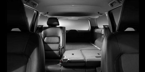 Motor vehicle, Mode of transport, Transport, Car seat, Head restraint, Vehicle door, Car seat cover, Automotive window part, Seat belt, Commercial vehicle,