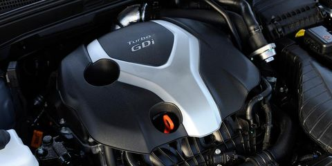 Automotive design, Motorcycle, Motorcycle accessories, Engine, Carbon, Automotive fuel system, Fuel tank, Personal luxury car, Leather, Kit car,