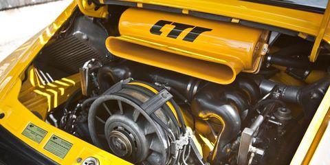 Motor vehicle, Yellow, Automotive design, Engine, Automotive exterior, Car, Automotive engine part, Hood, Bumper, Automotive air manifold,
