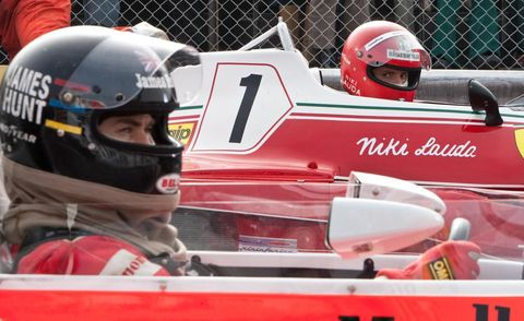 Automotive design, Helmet, Personal protective equipment, Red, White, Sports gear, Racing, Sports, Logo, Open-wheel car,