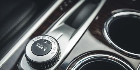 Automotive design, Logo, Metal, Carbon, Close-up, Luxury vehicle, Brand, Silver, Circle, Personal luxury car,