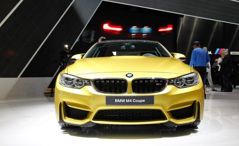 Motor vehicle, Automotive design, Yellow, Vehicle, Automotive exterior, Automotive lighting, Grille, Car, Hood, Headlamp,