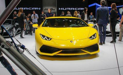 Automotive design, Yellow, Event, Vehicle, Performance car, Car, Supercar, Sports car, Personal luxury car, Auto show,