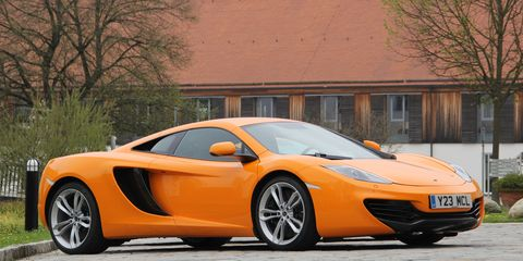 Tire, Wheel, Mode of transport, Automotive design, Vehicle, Transport, Land vehicle, Orange, Car, Supercar,