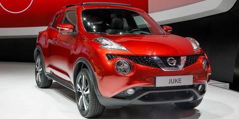 Motor vehicle, Automotive design, Product, Vehicle, Land vehicle, Car, Red, Automotive lighting, Fender, Bumper,