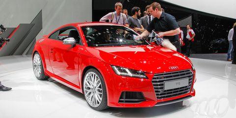 Automotive design, Vehicle, Event, Land vehicle, Car, Red, Grille, Auto show, Personal luxury car, Exhibition,